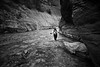 Zion, The Narrows - Woman hiking in river, black and white