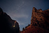 Zion, Big Bend - Rock formations surrounding climbers ascending Moonlight Buttress at night
