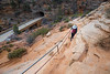 Zion, Canyon Overlook - Woman hiking above road and tunnel entrance