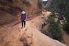 Zion, Canyon Overlook - Woman hiking along edge of canyon