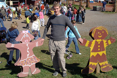 Rob, leading the ginger-bread family across the street - Centreville, VA ... October 15, 2006 ... Photo by Emily Conger