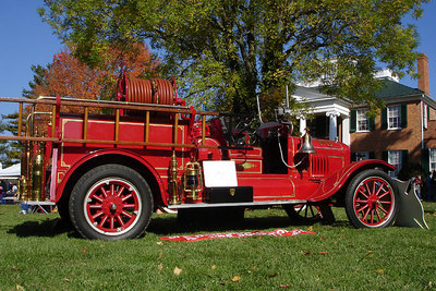 The old fashioned fire engine with the plantation in the background - Millwood, VA ... October 21, 2006 ... Photo by Rob Page III