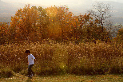 A child plays in the golden sunlight - Shenandoah NP, VA ... November 1, 2008 ... Photo by Rob Page III