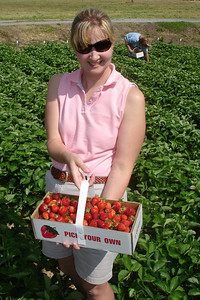 Sarah and her strawberries - Richmond, VA ... May 19, 2007 ... Photo by Rob Page III