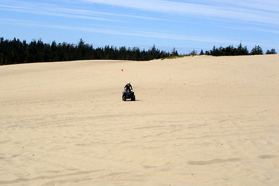 Heather, racing across the dunes - Oregon Sand Dunes National Recreation Area, OR ... July 29, 2006 ... Photo by Bob Page, Jr.