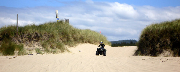Heather enjoying the sands with her ATV from Spinreel - Oregon Sand Dunes National Recreation Area, OR ... July 29, 2006 ... Photo by Bob Page, Jr.