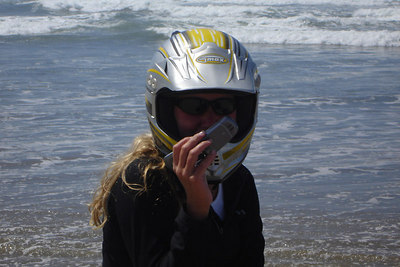 Heather, attempting to use her cell phone until she realized the helment did not have room for it - Oregon Sand Dunes National Recreation Area, OR ... July 29, 2006 ... Photo by Bob Page, Jr.