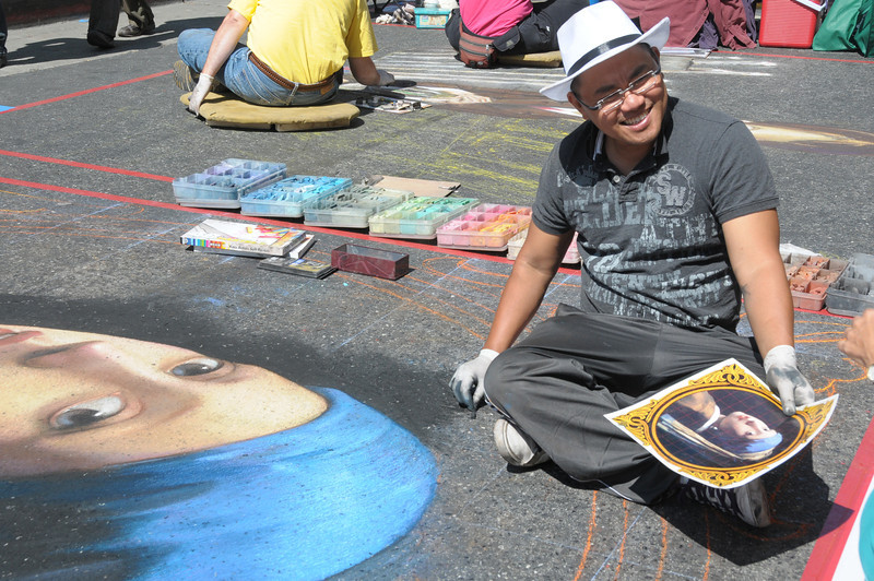 Cuong Nguyen takes a quick smile break while working on Girl with the Pearl Earring