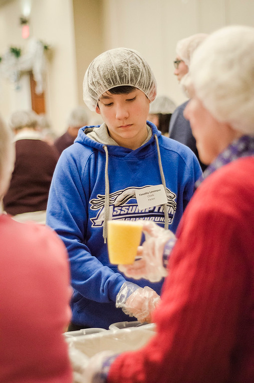 . Timothy Levesque worked along with an estimated 400 volunteers gathered at the DoubleTree by Hilton Hotel in Leominster on Thursday evening. During the event, which was organized by the United Way of North Central Massachusetts to commemorate Dr. Martin Luther King\'s Day of Service, volunteers were able to package more than 100,000 meals for 20 local food pantries.  SENTINEL & ENTERPRISE / Ashley Green