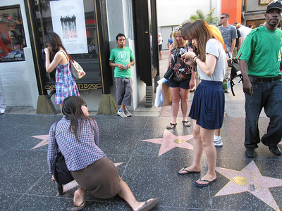 Tourists Posing at the Hollywood Walk of Fame