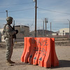 U.S. Army Spc. Triston Plumley, Military Police, 42nd Military Police Brigade, stands guard at the entrance to Ruba, Forward Operating Base, National Training Center, Ft. Irwin, CA., Jan. 10, 2017. The National Training Center conducts tough, realistic, Unified Land Operations with our United Action Partners to prepare Brigade Combat Teams and other units for combat while taking care of Soldiers, Civilians, and Family members. (U.S. Army Spc. Tracy McKithern/Released)