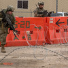 "U.S. Army Soldiers participate in a simulated hostile attack tothe Forward Operating Base entrance in order to prepare for ""in the box"" training exercises to begin, Ruba Forward Operating Base, National Training Center, Ft. Irwin, CA., Jan. 12, 2017. The National Training Center conducts tough, realistic, Unified Land Operations with our United Action Partners to prepare Brigade Combat Teams and other units for combat while taking care of Soldiers, Civilians, and Family members. (U.S. Army Spc. Tracy McKithern/Released)"