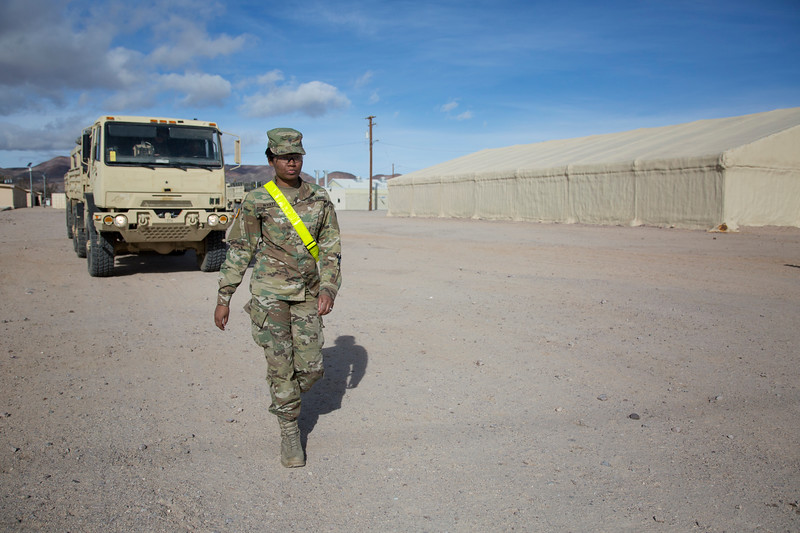 A U.S. Army Soldiers ground guides a military vehicle to a training exercise, National Training Center, Ft. Irwin, CA., Jan. 10, 2017. The National Training Center conducts tough, realistic, Unified Land Operations with our United Action Partners to prepare Brigade Combat Teams and other units for combat while taking care of Soldiers, Civilians, and Family members. (U.S. Army Spc. Tracy McKithern/Released)