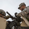 """U.S. Army Pvt. Helfritz Lettuvae, left, Motor Transport Operator and Spc. Tyler Jenkins, right, attach a blank firing adapter to a M2A1 Machine Gun for training exercises """"in the box"""", Ruba Forward Operating Base, National Training Center, Ft. Irwin, CA., Jan. 12, 2017. The National Training Center conducts tough, realistic, Unified Land Operations with our United Action Partners to prepare Brigade Combat Teams and other units for combat while taking care of Soldiers, Civilians, and Family members. (U.S. Army Spc. Tracy McKithern/Released)"""