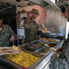 U.S. Army Soldiers assigned to the 3rd Battalion, 21st Infantry Regiment, Fort Wainwright, Alaska, serve a hot meal for 850 Soldiers who have been mostly eating Meals Ready to Eat as they have been training for several hours in cold weather during NTC 17-03, National Training Center, Ft. Irwin, CA., Jan. 18, 2017. The National Training Center conducts tough, realistic, Unified Land Operations with our United Action Partners to prepare Brigade Combat Teams and other units for combat while taking care of Soldiers, Civilians, and Family members. (U.S. Army Spc. Tracy McKithern/Released)