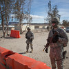 U.S. Army Spc. Triston Plumley, right, and Spc. Andrew Tagalicod, left, both Military Police, 42nd Military Police Brigade, stands guard at the entrance to Ruba, Forward Operating Base, National Training Center, Ft. Irwin, CA., Jan. 10, 2017. The National Training Center conducts tough, realistic, Unified Land Operations with our United Action Partners to prepare Brigade Combat Teams and other units for combat while taking care of Soldiers, Civilians, and Family members. (U.S. Army Spc. Tracy McKithern/Released)