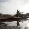U.S. Army Soldiers prepare to conduct various forms of training exercises in the rain, Ruba, Forward Operating Base, National Training Center, Ft. Irwin, CA., Jan. 11, 2017. The National Training Center conducts tough, realistic, Unified Land Operations with our United Action Partners to prepare Brigade Combat Teams and other units for combat while taking care of Soldiers, Civilians, and Family members. (U.S. Army Spc. Tracy McKithern/Released)