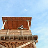 U. S. Army Pfc. Eric Gray, 3rd Battalion, 21st Infantry Regiment, Fort Wainwright, Alaska, stand in a tower guarding other U.S. Army Soldiers participating in a training exercise, National Training Center, Ft. Irwin, CA., Jan. 10, 2017. The National Training Center conducts tough, realistic, Unified Land Operations with our United Action Partners to prepare Brigade Combat Teams and other units for combat while taking care of Soldiers, Civilians, and Family members. (U.S. Army Spc. Tracy McKithern/ Released)