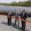 Unitil held a ribbon cutting for their new solar field on Sawyer Passway in Fitchburg on Wednesday morning. This field has 3,708 solar panels with 144 muilt-crystalline cells. The land was the site of a fossil fuel power plant for 100 years before Unitil put up the solar field. Tom Meissner the Chief Executive Officer and President of Unitil cuts the ribbon at the event. With him is Mayor Stephen DiNatale, on left, and Steve Remen the Executive Vice President of Unitil. SENTINEL & ENTERPRISE/JOHN LOVE