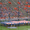Crowd stands for the Pledge of Allegiance to a gigantic American flag at the University of Florida's football game against Florida Atlantic University.