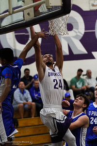 Oroville High School's Nikko Lobo goes up for a breakaway layup since University Prep's defenders unable to stop him during  boys basketball November 29, 2016 in Oroville, California. . (Emily Bertolino -- Mercury Register)