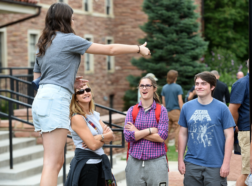 . Laura Hamilton, left, her daughter, Anna, and Brent Holcomb, listen to tour guide, MacKenzie Vertner, during one of the campus tours at the University of Colorado. For more photos, go to dailycamera.com. Cliff Grassmick  Staff Photographer  August 3, 2018