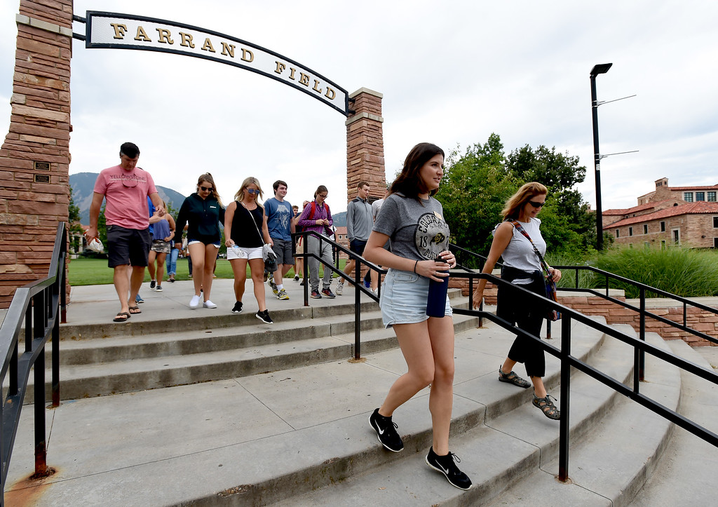 . Kenzie Vertner, a CU senior, leads one of the campus tours at the University of Colorado. She is answering a question from parent, Laura Hamilton, of Los Angeles. For more photos, go to dailycamera.com. Cliff Grassmick  Staff Photographer  August 3, 2018