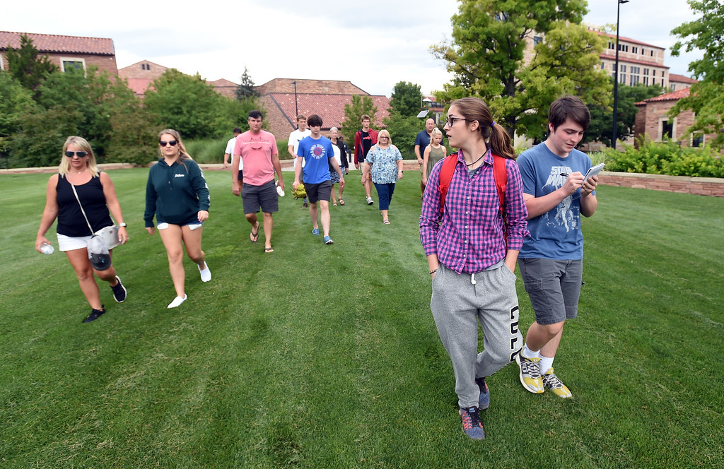 . Anna Hamilton and Brent Holcomb, right,  walk through Farrand Field during one of the campus tours at the University of Colorado. For more photos, go to dailycamera.com. Cliff Grassmick  Staff Photographer  August 3, 2018