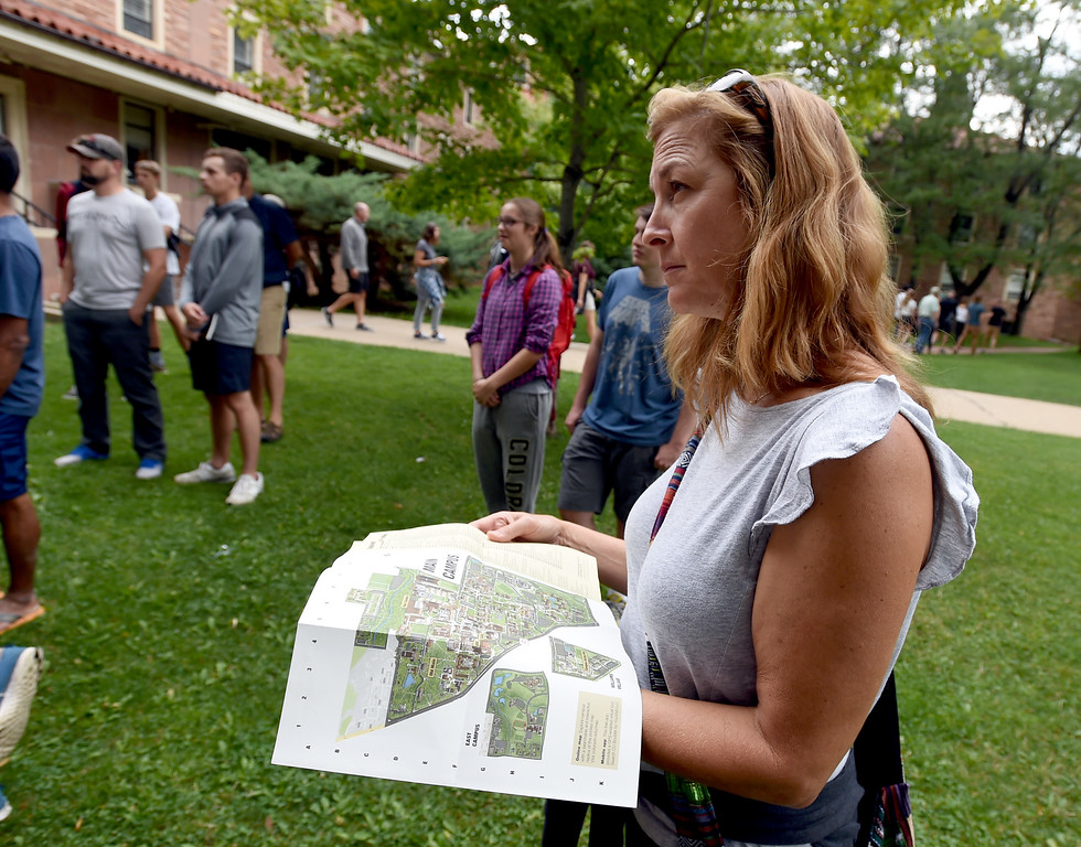 . Laura Hamilton, of Los Angeles, looks over a campus map during one of the campus tours at the University of Colorado. For more photos, go to dailycamera.com. Cliff Grassmick  Staff Photographer  August 3, 2018