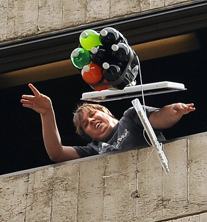 "CU student, Ian Core, releases one of the entries that has an Apple computer and liters of soda protecting the egg.<br /> The University of Colorado School of Engineering held the egg drop event for CU Engineering Days on Thursday.<br /> For more photos and a video of the egg drop, go to  <a href=""http://www.dailycamera.com"">http://www.dailycamera.com</a>.<br /> Cliff Grassmick / April 19, 2012"
