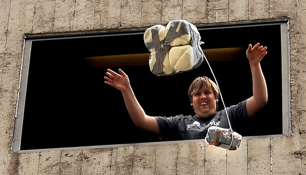 "CU student, Ian Core, releases one of the entries that has four gallons of milk as part of the device. The egg did not break.<br /> The University of Colorado School of Engineering held the egg drop event for CU Engineering Days on Thursday.<br /> For more photos and a video of the egg drop, go to  <a href=""http://www.dailycamera.com"">http://www.dailycamera.com</a>.<br /> Cliff Grassmick / April 19, 2012"