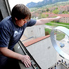 "Ian Core releases the first device from the 8th floor of the engineering tower.<br /> The University of Colorado School of Engineering held the egg drop event for CU Engineering Days on Thursday.<br /> For more photos and a video of the egg drop, go to  <a href=""http://www.dailycamera.com"">http://www.dailycamera.com</a>.<br /> Cliff Grassmick / April 19, 2012"