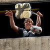 """CU student, Ian Core, releases one of the entries that has four gallons of milk as part of the device. The egg did not break.<br /> The University of Colorado School of Engineering held the egg drop event for CU Engineering Days on Thursday.<br /> For more photos and a video of the egg drop, go to  <a href=""""http://www.dailycamera.com"""">http://www.dailycamera.com</a>.<br /> Cliff Grassmick / April 19, 2012"""