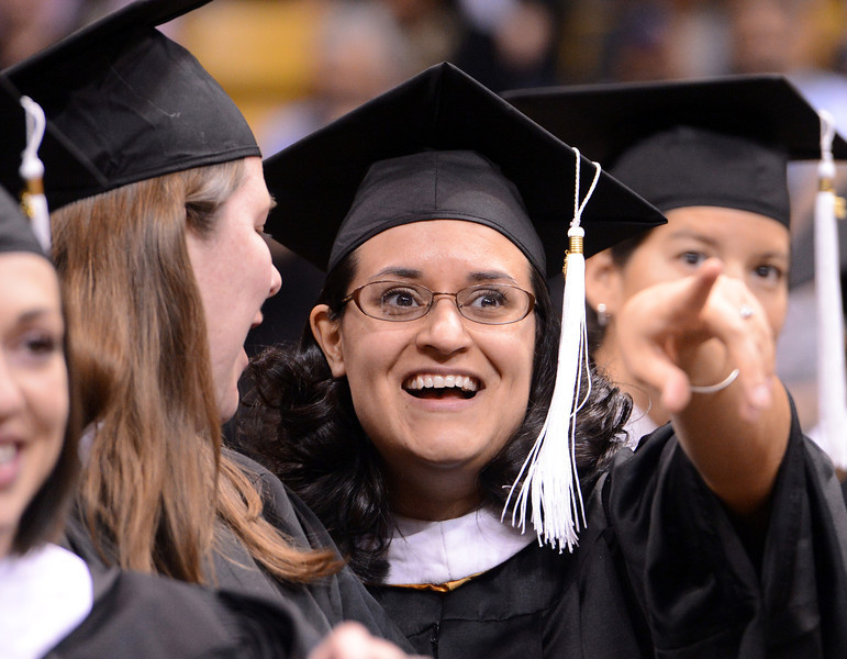 """Renee Lineberger points out someone in the crowd before getting her Master's Degree.<br /> The University of Colorado Boulder held its winter commencement ceremony on Friday, Dec. 21, in the Coors Events Center<br /> For more photos and a video of graduation, go to  <a href=""""http://www.dailycamera.com"""">http://www.dailycamera.com</a>.<br /> Cliff Grassmick  / December 21, 2012"""