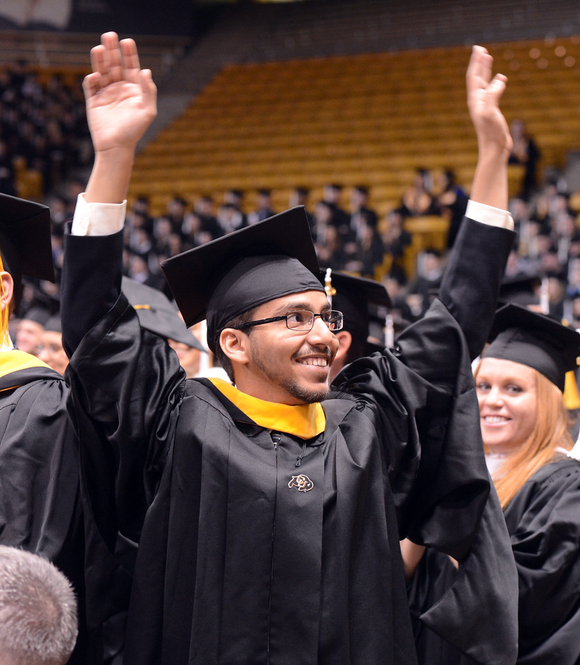 """Khalid Alharbi acknowledges his fans after getting his Master's Degree.<br /> The University of Colorado Boulder held its winter commencement ceremony on Friday, Dec. 21, in the Coors Events Center<br /> For more photos and a video of graduation, go to  <a href=""""http://www.dailycamera.com"""">http://www.dailycamera.com</a>.<br /> Cliff Grassmick  / December 21, 2012"""