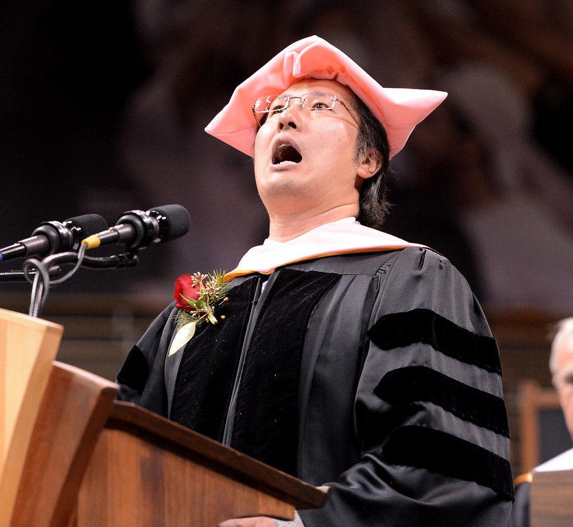 """Jeong-Kwon Kim sings """"America the Beautiful"""" during the  graduation ceremony.<br /> The University of Colorado Boulder held its winter commencement ceremony on Friday, Dec. 21, in the Coors Events Center<br /> For more photos and a video of graduation, go to  <a href=""""http://www.dailycamera.com"""">http://www.dailycamera.com</a>.<br /> Cliff Grassmick  / December 21, 2012"""