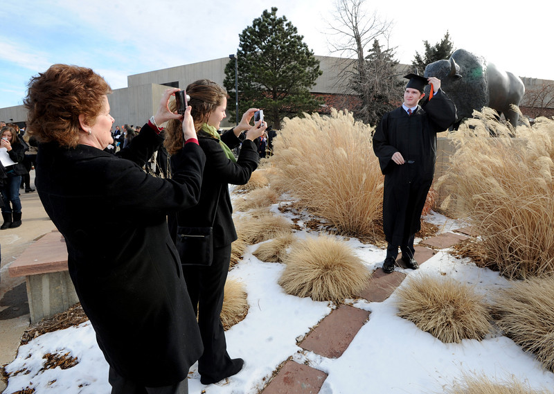 """Sean Egan, right, is photographed by his mother, Susan, and sister, Sarah, outside the Coors Events Center.<br /> The University of Colorado Boulder held its winter commencement ceremony on Friday, Dec. 21, in the Coors Events Center<br /> For more photos and a video of graduation, go to  <a href=""""http://www.dailycamera.com"""">http://www.dailycamera.com</a>.<br /> Cliff Grassmick  / December 21, 2012"""