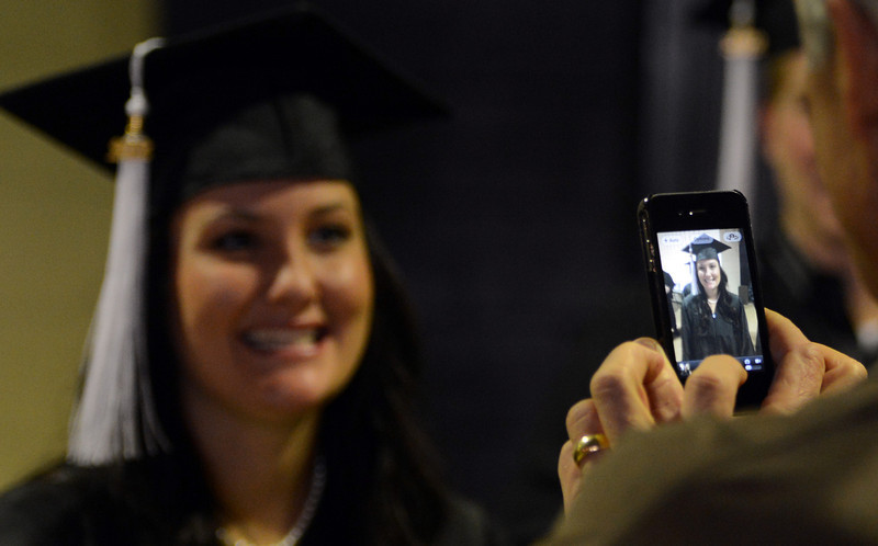"""CU grad, Kori Powell, is photographed by  her dad, Greg Carlisle, before the ceremony.<br /> The University of Colorado Boulder held its winter commencement ceremony on Friday, Dec. 21, in the Coors Events Center<br /> For more photos and a video of graduation, go to  <a href=""""http://www.dailycamera.com"""">http://www.dailycamera.com</a>.<br /> Cliff Grassmick  / December 21, 2012"""