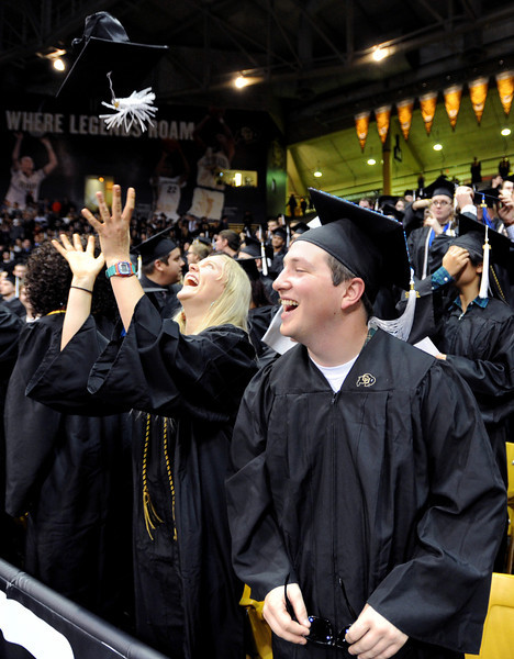 "Michelle Pitcher, left, and Patrick Forenza, are happy to be new graduates.<br /> The University of Colorado Boulder held its winter commencement ceremony on Friday, Dec. 21, in the Coors Events Center<br /> For more photos and a video of graduation, go to  <a href=""http://www.dailycamera.com"">http://www.dailycamera.com</a>.<br /> Cliff Grassmick  / December 21, 2012"