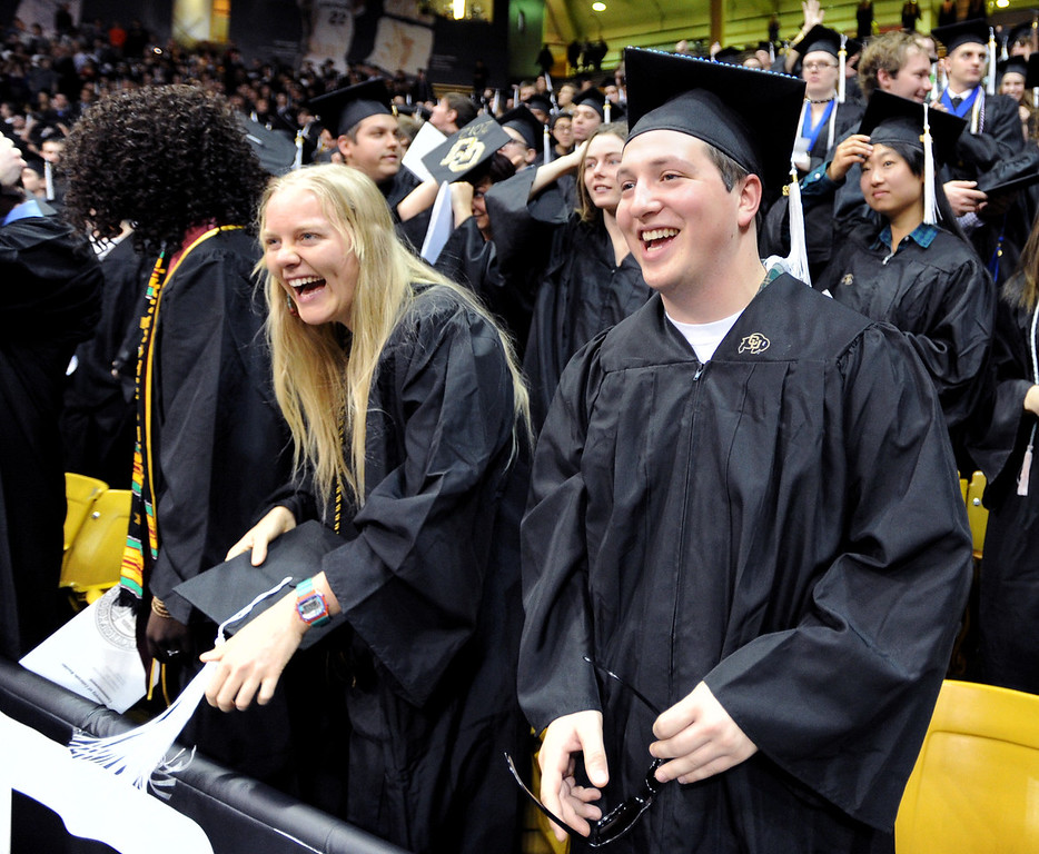 """Michelle Pitcher, left, and Patrick Forenza, are happy to be new graduates.<br /> The University of Colorado Boulder held its winter commencement ceremony on Friday, Dec. 21, in the Coors Events Center<br /> For more photos and a video of graduation, go to  <a href=""""http://www.dailycamera.com"""">http://www.dailycamera.com</a>.<br /> Cliff Grassmick  / December 21, 2012"""