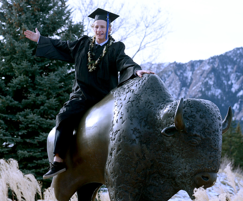 """CU grad, Scott Thomas, looks like he may ride the buffalo into the sunset after graduation on Friday.<br /> The University of Colorado Boulder held its winter commencement ceremony on Friday, Dec. 21, in the Coors Events Center<br /> For more photos and a video of graduation, go to  <a href=""""http://www.dailycamera.com"""">http://www.dailycamera.com</a>.<br /> Cliff Grassmick  / December 21, 2012"""