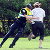 A police officer attempts to  tackle a man who ran onto the Norlin Quad as the time turned to 4:20 on the CU Boulder Campus  Friday afternoon April 20, 2012. <br /> <br /> Photo by Paul Aiken   /  The Camera