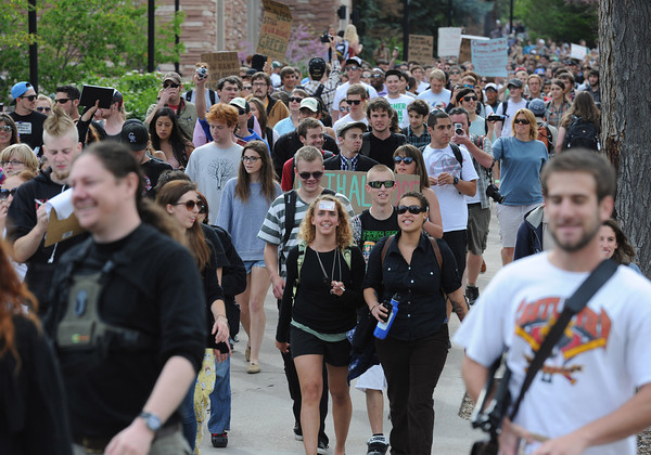 "Participants and spectators walk through CU's campus from the Norlin <br /> Quadrangle to the field behind the Duane Physics building during the 4/20 demonstration Friday, April, 20, 2012.<br /> Photo by Lewis Geyer<br /> For more photos and video visit  <a href=""http://www.dailycamera.com"">http://www.dailycamera.com</a>"