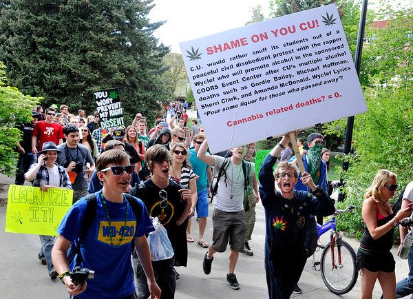"Marijuana supporters march together through the University of Colorado campus in Boulder during the 4/20 rally on Friday, April 20. For more photos and video go to  <a href=""http://www.dailycamera.com"">http://www.dailycamera.com</a><br /> Jeremy Papasso/ Camera"