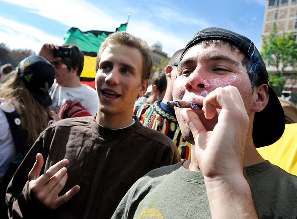 "An unidentified man smokes a blunt of marijuana outside the Duane Physics building during the 4/20 rally on the University of Colorado campus in Boulder on Friday, April 20. For more photos and video go to  <a href=""http://www.dailycamera.com"">http://www.dailycamera.com</a><br /> Jeremy Papasso/ Camera"