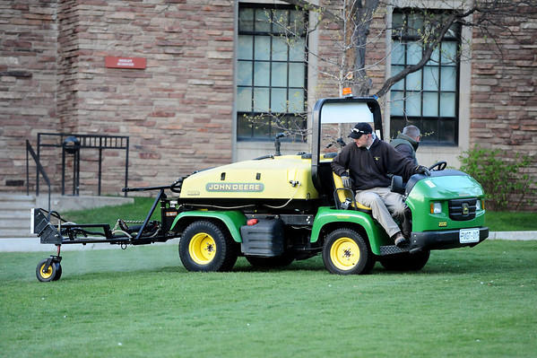 Crewman apply fish spray on the Norlin Quad of the University of Colorado Boulder Campus  Friday April 20, 2012.<br /> <br /> Photo by Paul Aiken   /  The Camera