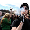 "An unidentified man smokes a marijuana cigarette outside of the Duane Physics building during the 4/20 rally on the University of Colorado campus in Boulder on Friday, April 20. For more photos and video go to  <a href=""http://www.dailycamera.com"">http://www.dailycamera.com</a><br /> Jeremy Papasso/ Camera"
