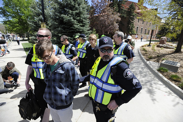 "University of Colorado senior Jonathan Edwards, front, and senior John Demopoulos, middle, are arrested by Boulder County Sheriff deputies for trespassing on Norlin Quad by going past the police tape on the University of Colorado campus in Boulder on April 20, 2012. For more photos and video of 4/20 on the CU campus in Boulder go to  <a href=""http://www.dailycamera.com"">http://www.dailycamera.com</a><br /> Jeremy Papasso/ Camera"