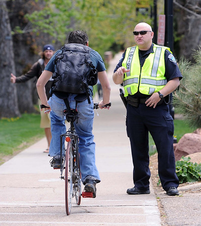 "Boulder Police officer, C. Nicolas stops a cyclist to check his student ID.<br /> For more photos and videos of 4/20,  go to  <a href=""http://www.dailycamera.com"">http://www.dailycamera.com</a><br />  Cliff Grassmick / April 20, 2012"