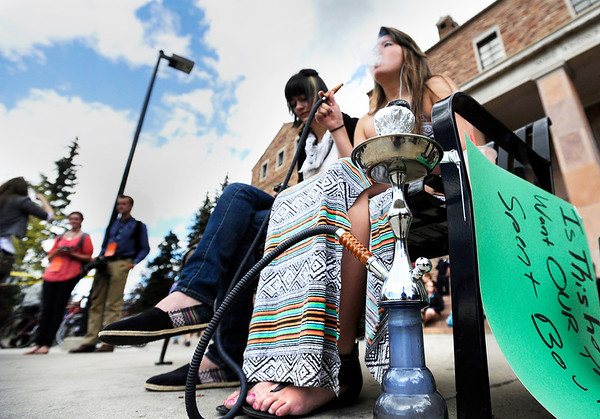 "University of Colorado freshman Hilary Johnston, left, and freshman Nicole Buggy on the University of Colorado campus in Boulder on April 20, 2012. For more photos and video of 4/20 on the CU campus in Boulder go to  <a href=""http://www.dailycamera.com"">http://www.dailycamera.com</a><br /> Jeremy Papasso/ Camera"